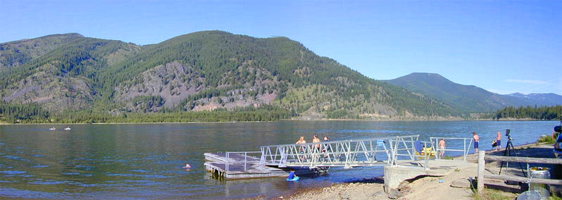 Noxon Rapids Dam, and children swimming by the Trout Creek Dock